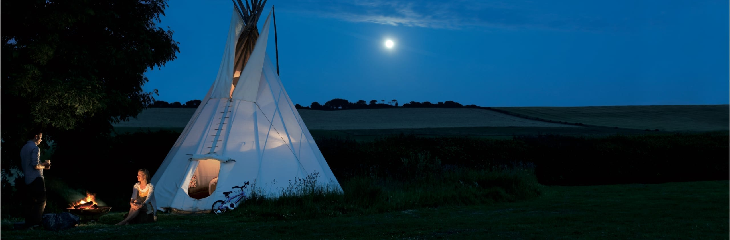 Tipi tent erect in field